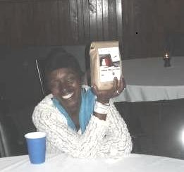 Patricia Wynter with her door prize, our new Stories in the North coffee-blend, Looming Deadline.